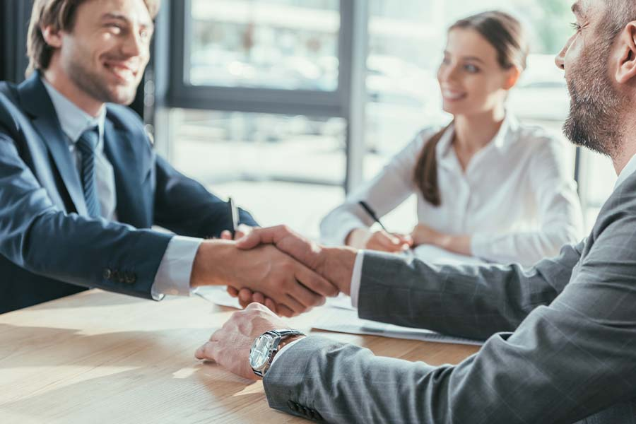 Business Insurance - Business People Shaking Hands During a Meeting in a Modern Office