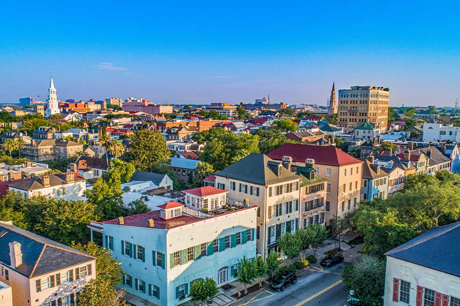 Contact - Aerial View of City and Rainbow Row in Charleston, South Carolina at Sunset